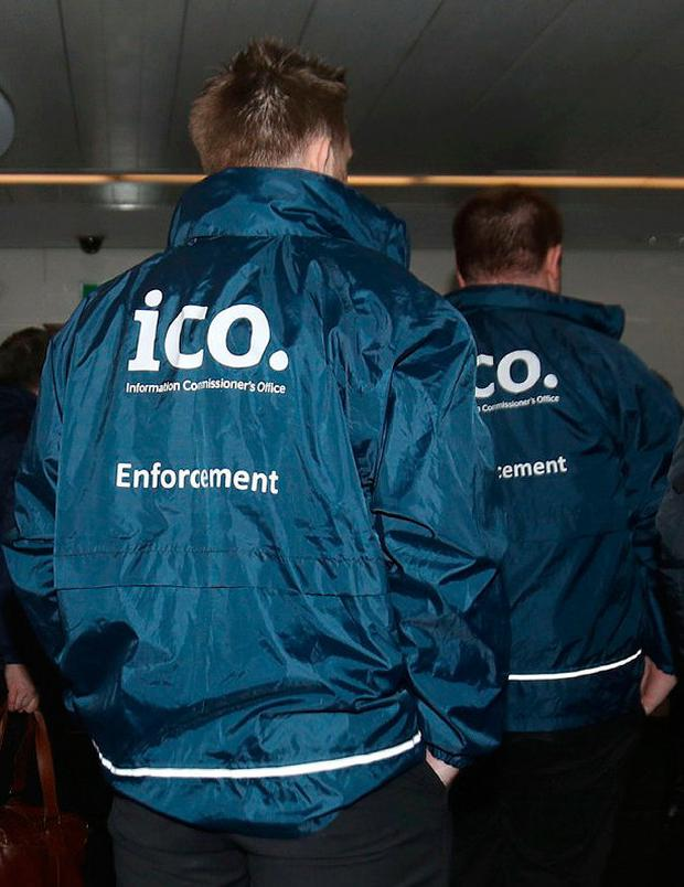 Enforcement officers working for the Information Commissioner's Office entering the premises of Cambridge Analytica after a High Court judge granted a search warrant Photo credit: Yui Mok/PA Wire