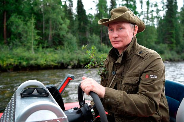 Russian President Vladimir Putin during a holiday last year in the remote Tuva region of Siberia. Photo: Getty Images