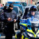 Police at the scene in Trebes, France, where three people were shot dead. Photo: Reuters
