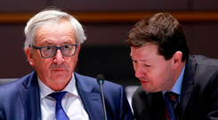 European Commission President Jean-Claude Juncker attends the European Union leaders summit in Brussels with the embattled Martin Selmayr. Photo: Olivier Hoslet/ Reuters