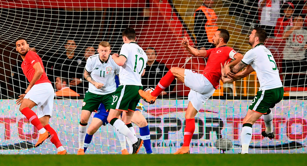 SLOPPY DEFENDING: Turkey's Mehmet Topal scores the only goal of the game ahead of Ireland's Shane Duffy; (Inset below) Republic of Ireland debutant Declan Rice. Photo: Stephen McCarthy/Sportsfile
