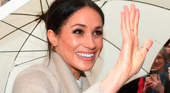 Meghan Markle waves to the crowds during her tour of Belfast yesterday. Photo: PA