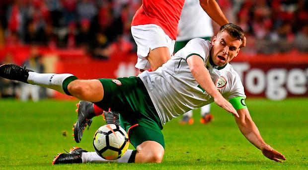 Ireland captain Seamus Coleman is tackled by Turkey's Emre Akbaba during last night's friendly in Antalya. Photo: Stephen McCarthy/Sportsfile