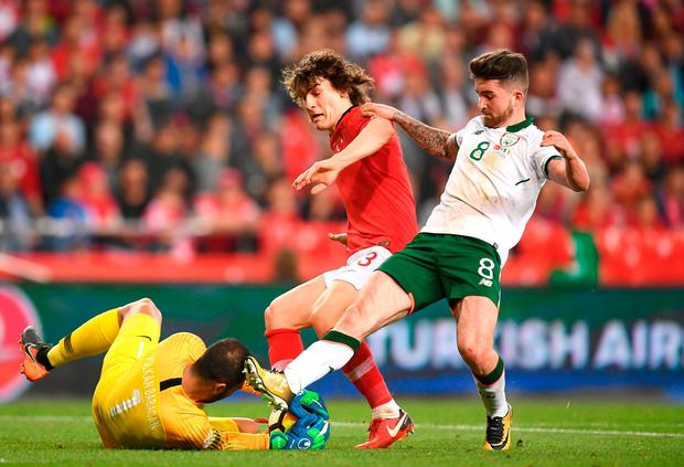 Ireland's Sean Maguire puts his foot in to challenge Turkey 'keeper Volkan Babacan (L) and Çaglar Söyüncü. Photo: Stephen McCarthy/Sportsfile