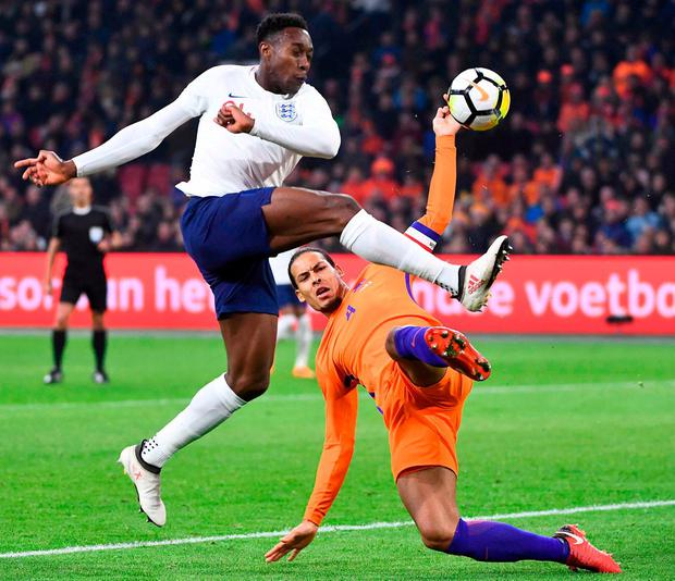 Danny Welbeck battles it out with Virgil van Dijk during last night's match between England and Holland at the Amsterdam Arena. Photo: Emmanuel Dunand/AFP/Getty Images