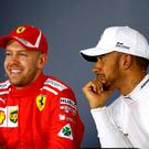 Ferrari's Sebastian Vettel and Mercedes' Lewis Hamilton during the press conference after qualifying. REUTERS/Brandon Malone
