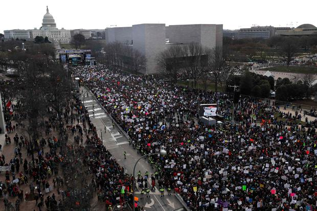 As seen from the Newseum building, students and gun control advocates participate in the