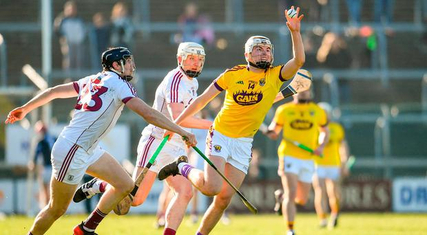Rory O'Connor of Wexford in action against Joseph Cooney, left, and Joe Canning of Galway during the Allianz Hurling League Division 1 quarter-final match between Wexford and Galway at Innovate Wexford Park in Wexford. Photo by Sam Barnes/Sportsfile