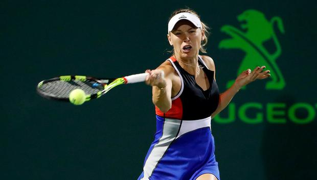 Caroline Wozniacki of Denmark hits a forehand against Monica Puig of Puerto Rico (not pictured) on day four of the Miami Open at Tennis Center at Crandon Park. Credit: Geoff Burke-USA TODAY Sports