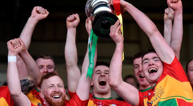 Carlow joint captains Eoin Nolan, left, and Richard Cody lift the cup after the Allianz Hurling League Division 2A Final match between Westmeath and Carlow at O'Moore Park in Portlaoise, Laois. Photo by Piaras Ó Mídheach/Sportsfile