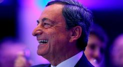 Mario Draghi's legacy is secure after his innovative approach boosted financial conditions. Photo: Ralph Orlowski/Reuters