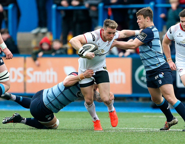 Craig Gilroy of Ulster is tackled by Josh Turnbull and Jarrod Evans of Cardiff Blues. Photo: Sportsfile