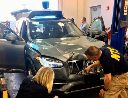 FATAL COLLISION: US National Transportation Safety Board NTSB investigators examine a self-driving Uber vehicle involved in a fatal accident in Tempe, Arizona, last week.