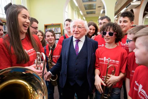 TRUMPET: President Michael D Higgins with Brian Cott and students from Music Generation in Cork City Library yesterday for the Cork Life Long Learning Festival. Photo: Darragh Kane