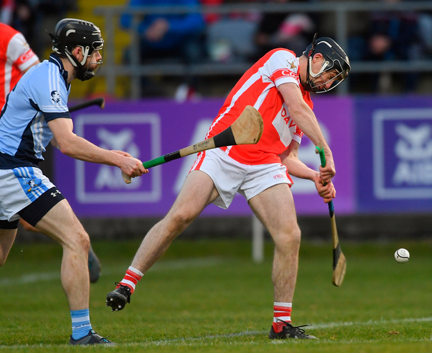 Mark Schutte of Cuala scores his side's first goal despite the efforts of Cathal King of Na Piarsaigh. Photo: Sportsfile