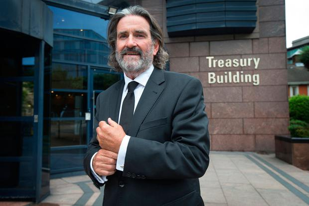 BACK TO THE DRAWING BOARD: Developer Johnny Ronan with the proposed Tara Street development in the background