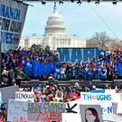 PUBLIC ANGER: Students gather on stage during the March for Our Lives Rally in Washington, DC. Photo: Alex Edelman/AFP
