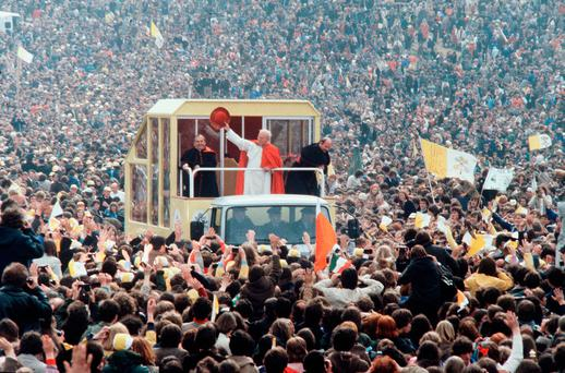 Unforgettable occasion: Pope John Paul II waves to cheering crowds from his Popemobile in September 1979 (Photo by Anwar Hussein/Getty Images)