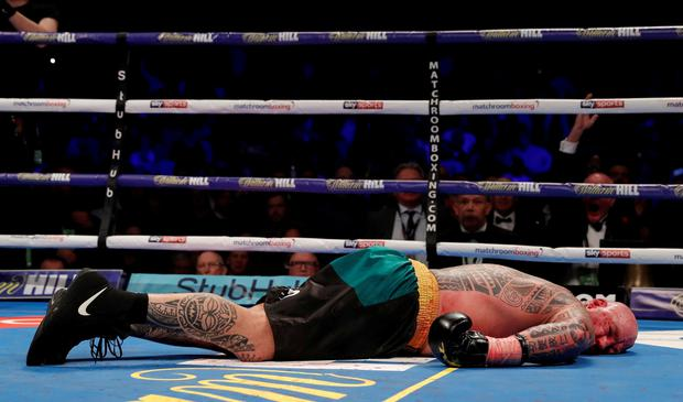 Lucas Browne lies on the canvas after he is knocked out by Dillian Whyte in the sixth round. Action Images via Reuters/Andrew Couldridge