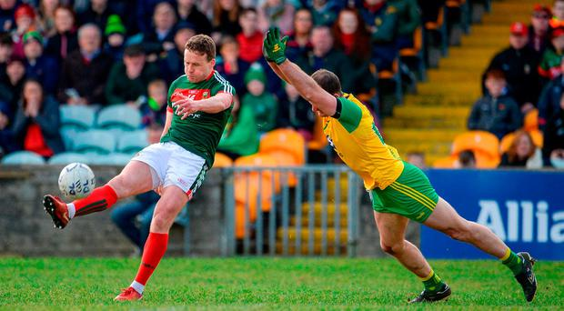 Andy Moran of Mayo in action against Neil McGee of Donegal during the Allianz Football League Division 1 Round 7 match between Donegal and Mayo at MacCumhaill Park in Ballybofey, Donegal. Photo by Oliver McVeigh/Sportsfile
