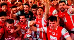 Cuala's players celebrate with the Tommy Moore Cup after their AIB All-Ireland club hurling final replay win over Na Piarsaigh. Photo: Piaras Ó Mídheach/Sportsfile