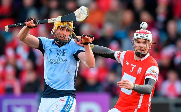 Cuala's Cian O'Callaghan battles for possession with David Breen of Na Piarsaigh. Photo: Piaras Ó Mídheach/Sportsfile