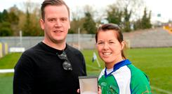 Tanya Johnson of Johnstownbridge receives the player of the match award from Patrick Somers of AIB after the AIB All-Ireland Intermediate Club Camogie Final match between Athenry and Johnstownbridge at St Tiernach's Park in Clones, Monaghan. Photo: Oliver McVeigh/Sportsfile
