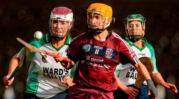 Slaughtneil's Tina Hannon breaks away from Kate Gallagher of Sarsfields. Photo: Oliver McVeigh/Sportsfile