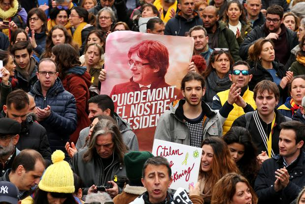 People protest after former president Carles Puigdemont was detained in Germany, during a demonstration held by pro-independence associations in Barcelona, Spain March 25, 2018. REUTERS/Albert Gea