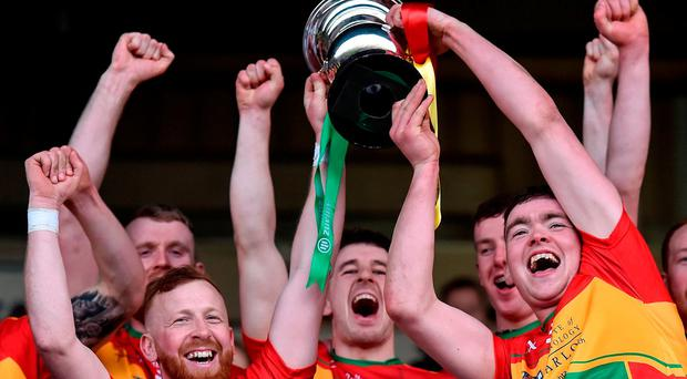 Carlow joint captains Eoin Nolan, left, and Richard Cody lift the cup after their Allianz Hurling League Division 2A Final victory over Westmeath in Portlaoise. Photo: Piaras Ó Mídheach/Sportsfile