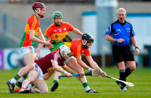 Alan Devine of Westmeath is crowded out by Carlow's, from left, Alan Corcoran, Richard Coady and Paul Coady. Photo: Piaras Ó Mídheach/Sportsfile