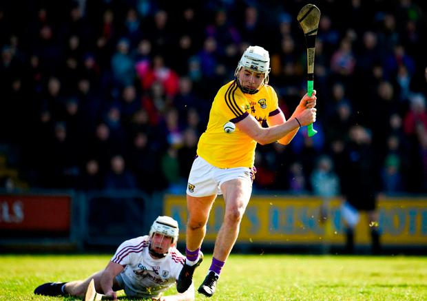 Wexford's Rory O'Connor takes a shot at goal despite the efforts of Jack Coyne. Photo: Sam Barnes/Sportsfile