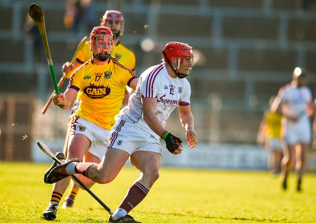 Conor Whelan loses hold of his hurl up against Wexford's Willie Devereux. Photo: Sam Barnes/Sportsfile