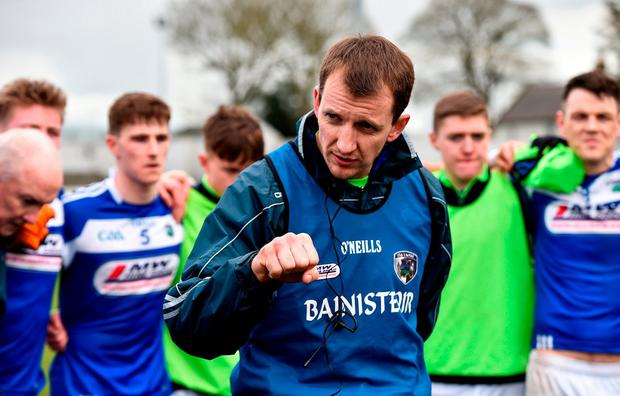 Laois manager John Sugrue speaks to his players following their side's victory in Carlow. Photo: Seb Daly/Sportsfile