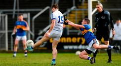Cavan's Conor Madden scores the winning point despite the efforts of Liam Boland. Photo: Piaras Ó Mídheach/Sportsfile