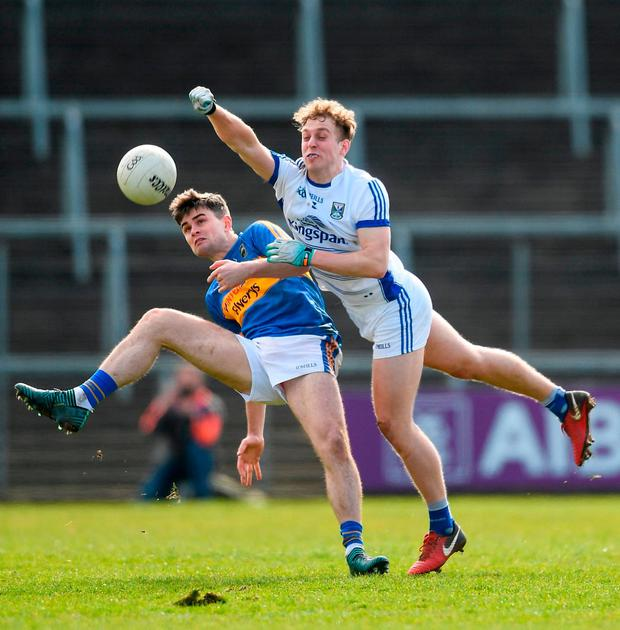 Tipperary's Michael Quinlivan feels the pressure from Cavan's Padraig Faulkner. Photo: Piaras Ó Mídheach/Sportsfile