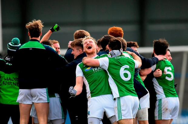 Fermanagh players celebrate their last-gasp promotion in Longford. Photo: Eóin Noonan/Sportsfile