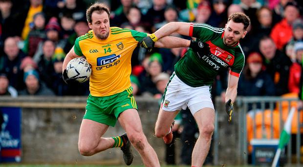 Donegal talisman Michael Murphy keeps Mayo's David Drake at arm's length in Ballybofey yesterday. Photo: Oliver McVeigh/Sportsfile