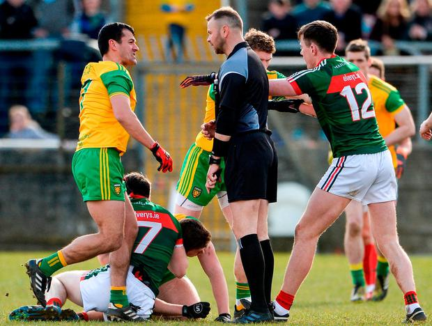 Players from both sides tussle in the closing minutes of the Allianz Football League Division 1 Round 7 match at MacCumhaill Park in Ballybofey, Donegal. Photo: Oliver McVeigh/Sportsfile