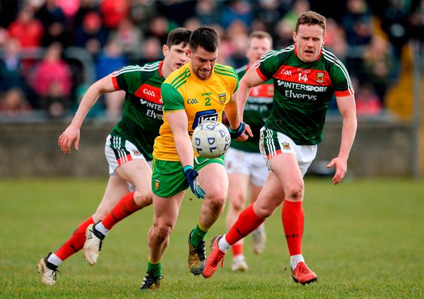 Donegal's Paddy McGrath breaks away from Conor Loftus, left, and Andy Moran. Photo: Oliver McVeigh/Sportsfile
