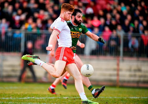 Tyrone's Cathal McShane lines up a shot under pressure from Cormac Coffey. Photo: Brendan Moran/Sportsfile