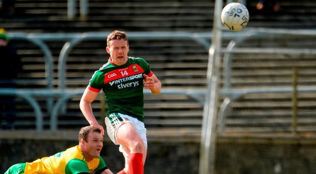 Mayo's Andy Moran fires a shot at the Donegal goal despite the best efforts of Neil McGee in Ballybofey yesterday. Photo: Oliver McVeigh/Sportsfile
