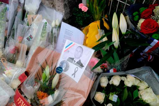 An image of Lieutenant Colonel Arnaud Beltrame on flowers at gates of the gendarmerie of Carcassonne in south-west France. Photo: AFP/Getty