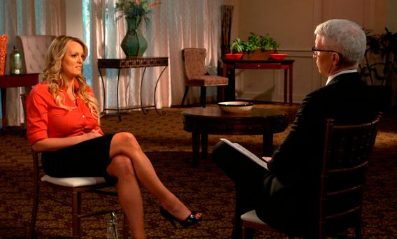 Stormy Daniels, left, during an interview with Anderson Cooper which will air on Sunday, March 25, on