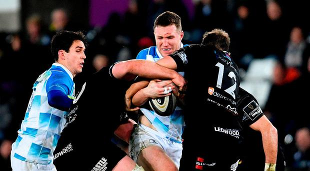 Rory O'Loughlin of Leinster is tackled by Rob McCusker, left, and Ashley Beck of Ospreys. Photo: Ramsey Cardy/Sportsfile