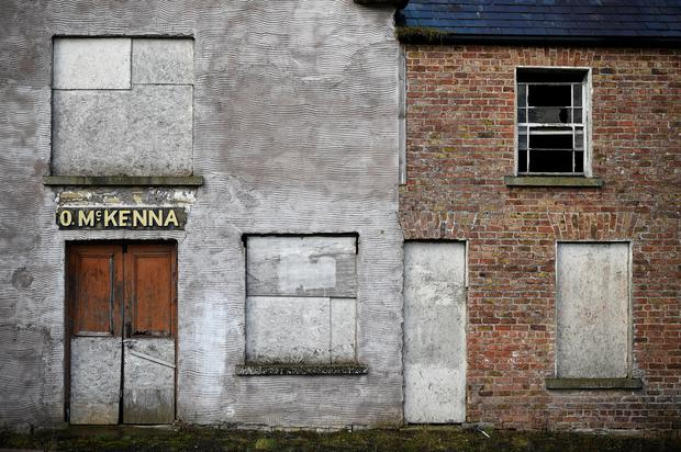 An abandoned shop is seen in Mullan, Ireland, March 16, 2018. The building was home to four families who left during The Troubles. The town was largely abandoned after the hard border was put in place during the conflict. Mullan has seen some regeneration in recent years, but faces an uncertain future with Brexit on the horizon. REUTERS/Clodagh Kilcoyne.