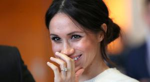 The fiancee of Britain's Prince Harry, Meghan Markle, reacts during a visit to a science park called Catalyst Inc., in Belfast, Northern Ireland March 23, 2018. Chris Jackson/Pool via Reuters