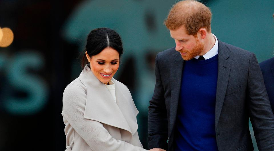 Britain's Prince Harry, and his fiancee Meghan Markle, leave after a visit to the Titanic tourist attraction in Belfast, Northern Ireland March 23, 2018. REUTERS/Darren Staples