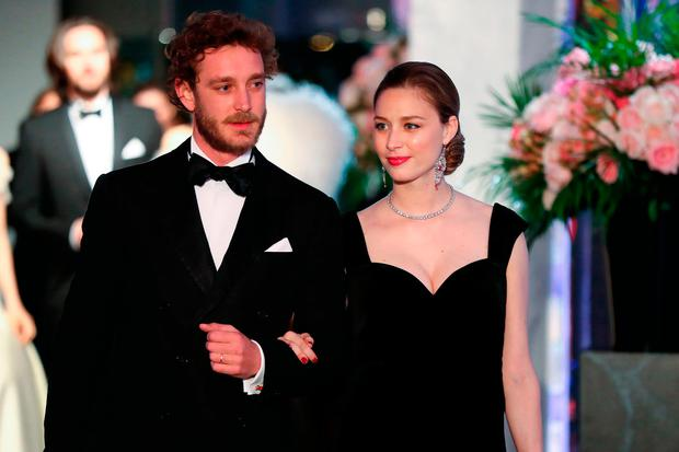 Pierre Casiraghi (R) and his wife Beatrice Casiraghi arrive for the annual Rose Ball at the Monte-Carlo Sporting Club in Monaco, on March 24, 2018