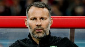 Wales manager Ryan Giggs looks on. REUTERS